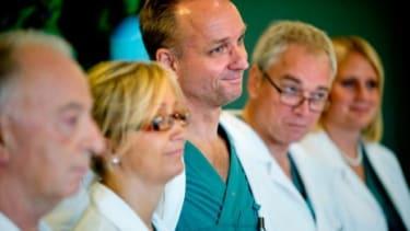 Surgeon Mats Brannstrom (center)