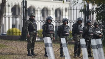 Police stand guard outside Pakistan's Supreme Court
