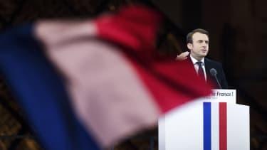 Emmanuel Macron speaks in front of The Louvre