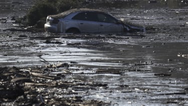 A car sits in flooded water in Montecito, California.