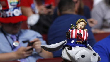 A delegate with a hat incorporating the Democratic donkey mascot and a figurine of Democratic U.S. presdential candidate Hillary Clinton.