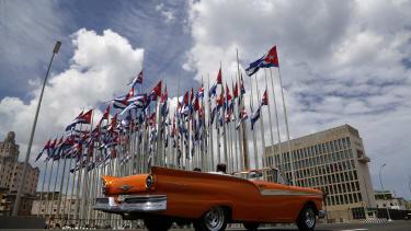 A car drives by the U.S. embassy in Cuba.
