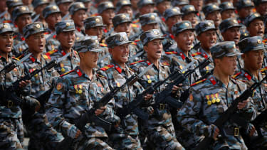 North Korean soldiers march during a military parade.