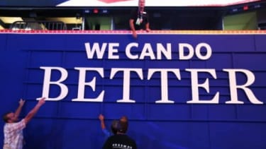 """Workers hang a campaign sign that reads """"We Can Do Better"""" ahead of the Republican National Convention at the Tampa Bay Times Forum: Mitt Romney, the presumptive GOP nominee will have to worr"""