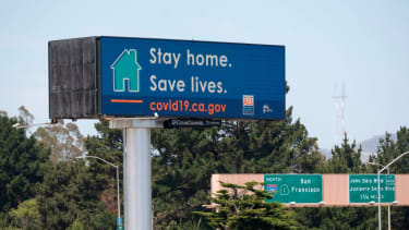 An electronic sign urging Californians to stay at home.