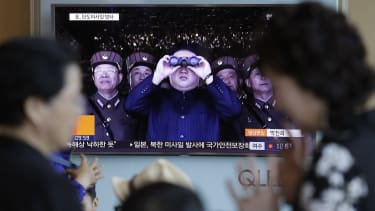 North Korean leader Kim Jong Un on a South Korean news report