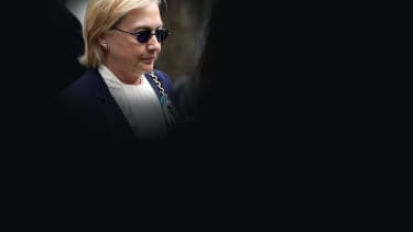 Hillary Clinton arrives at the 9/11 memorial.