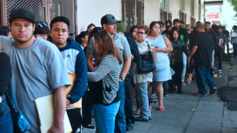 DACA recipients wait in line in Los Angeles to renew their work permits before the deadline.