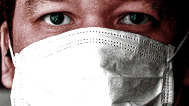 A man wearing a facemask.