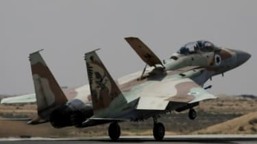 An Israeli air force F-15 fighter jet lands at the Hatzerim air base in Hatzerim southern Israel.