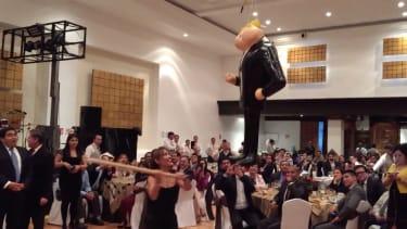 Mexican politicians take a whack at a Donald Trump piñata.