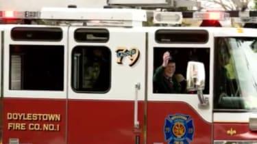 Bill Grun in a fire truck.