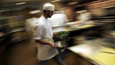 A chef inside a kitchen.