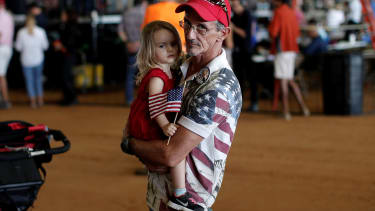 Steve Durand, and his daughter, attend a campaign rally for Donald Trump in Ocala, Florida, October 2016.