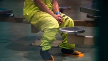An immigration detainee sits in a California jail.