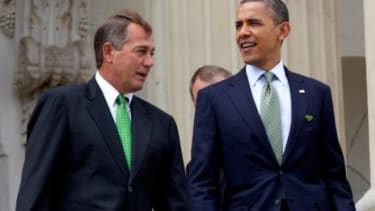 President Obama and House Speaker John Boehner make nice on St. Patrick's Day in 2011: The foes will have to join forces to avoid driving the country off the so-called fiscal cliff.