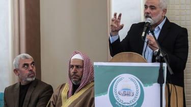 Yahya Sinwar (L) the new leader of Hamas in the Gaza Strip and senior political leaders of the Islamist movement Khalil al-Haya (C) Ismail Haniyeh (R)