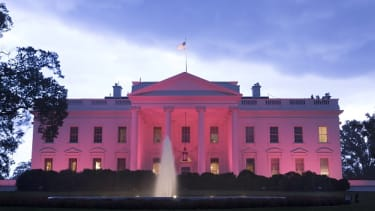 The White House lit by pink lighting for Breast Cancer Awareness Month in October.