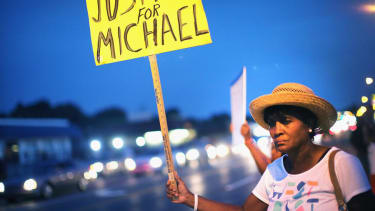 Michael Brown's killer reportedly skipped town days ago
