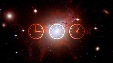 A galaxy overlayed with clocks.