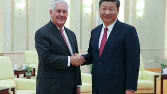 U.S. Secretary of State Rex Tillerson (L) shakes hands with Chinese President Xi Jinping (R)