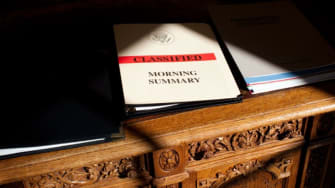 Classified information lies on the Resolute Desk in the Oval Office.