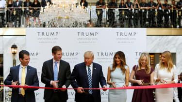 Trump and his family open the Trump International hotel in DC.