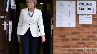 Theresa May leaves a polling station