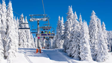 A Colorado athlete rescued a man dangling from a ski lift.