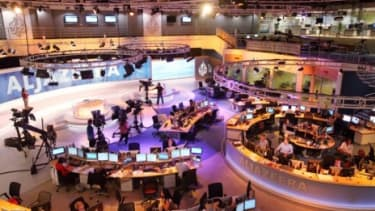 The bustling Al Jazeera newsroom: If a new computer program that creates news stories is any indication, journalism of the future may involve fewer human reporters and more software.