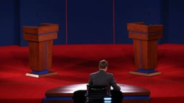 University of Denver student Sam Garry sits at the moderator's desk before a presidential debate dress rehearsal on Oct. 2: The debate will air tonight on all the major networks, and is avail