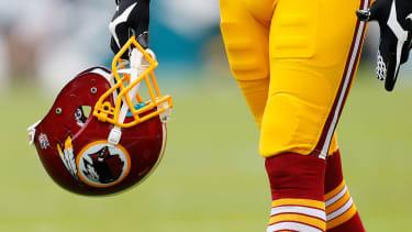 Redskins player with helmet.
