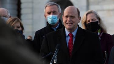 Bipartisan congressmembers celebrate coronavirus relief bill.