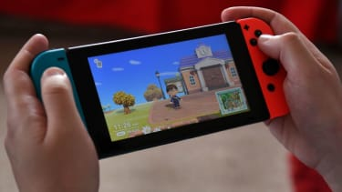 This photo taken on April 29, 2020 shows Australian high school teacher Dante Gabriele playing Nintendo's Animal Crossing at home in Melbourne during the country's enforced COVID-19 coronavir
