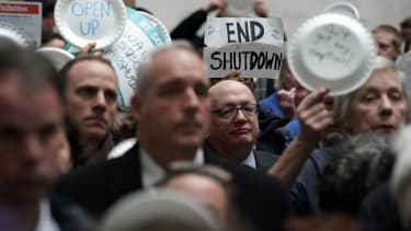 Government workers protest the shutdown.