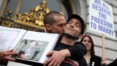 People celebrate in San Francisco Tuesday after a gay-marriage ban is overturned, although the federal appellate ruling may be too narrow to have an effect on any state other than California.