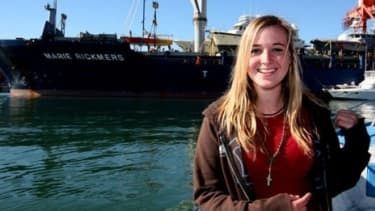 16-year-old Sunderland poses in front of her boat.