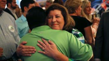 Karen Handel hugs a friend.