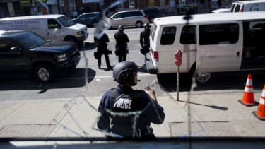 A police officer stands guard.