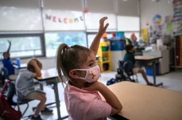 Harper Shea (5), raises her hand during her first day of kindergarten on September 9, 2020 in Stamford, Connecticut.