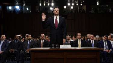 James Comey swears in.