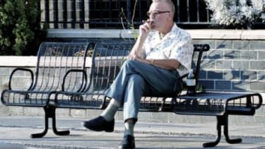 Mayor Bloomberg's new smoking ban would prevent people from lighting up while sitting on benches or hanging out in parks.