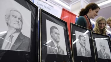 Drawings of the Republican presidential candidates are displayed at a booth at the annual Conservative Political Action Conference in Washington, D.C.