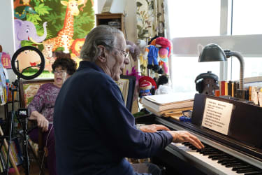 Peter and Veronica Fuchs sing in their apartment.