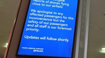 An information board announces flight disruption at London Gatwick Airport, south of London, on December 20, 2018 after all flights were grounded due to drones flying over the airfield.
