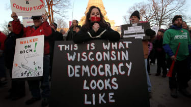 Federal judge strikes down Wisconsin voter ID law