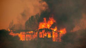 A house burns down near Finley, California.