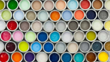 Dozens of cans of paint.