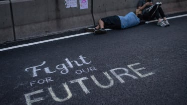 Hong Kong protesters agree to scale back demonstrations