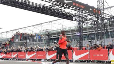 Olympic marathon champion Eliud Kipchoge crosses the finish line